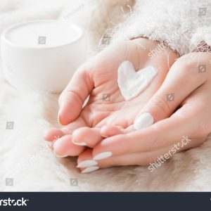 stock-photo--beautiful-groomed-woman-s-hands-with-cream-jar-on-the-fluffy-blanket-moisturizing-cream-for-clean-790646674