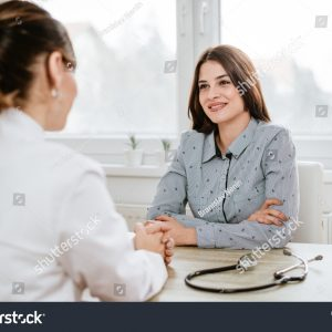 stock-photo-young-woman-at-doctor-s-office-795967777